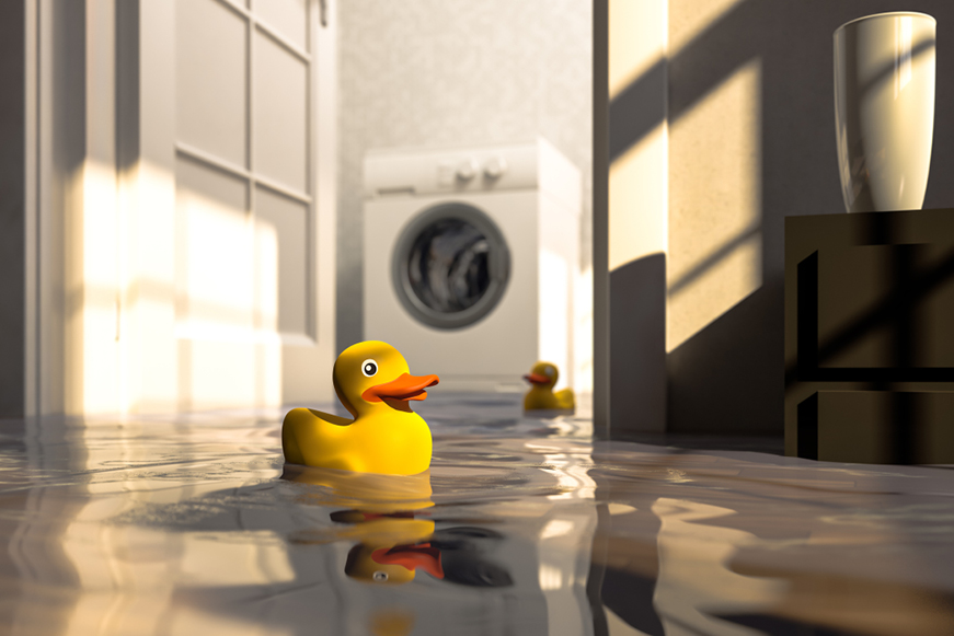 Rubber ducks floating on a flooded kitchen floor