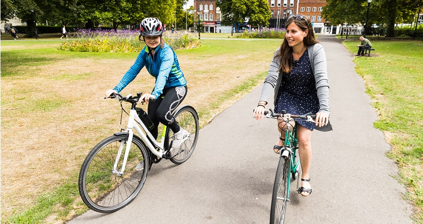 Two cyclists in park